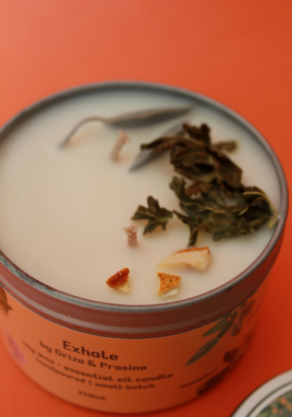 Close up on the Exhale candle, dried herbs on soy candle.