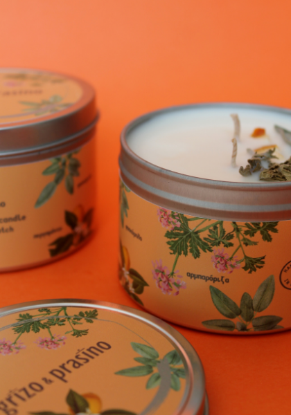 Three cans of the Exhale candle.