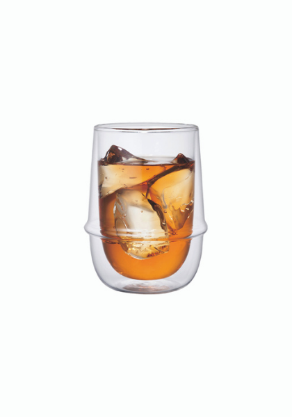 A Kinto Kronos glass with iced tea and ice cubes in it