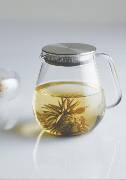 Kinto one touch unitea teapot with herbs in it.