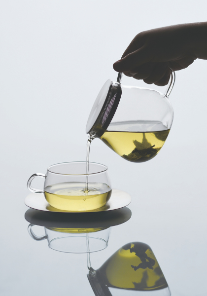 Serving tea from a teapot to a mug. Both are kinto unitea products.
